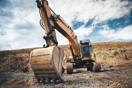 moving truck: Highway construction site excavator. details of roadworks with heavy duty machinery Stock Photo