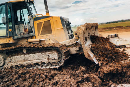 Industrial details - Mini bulldozer mover doing earthworks during landscaping Stock Photo - 82691729