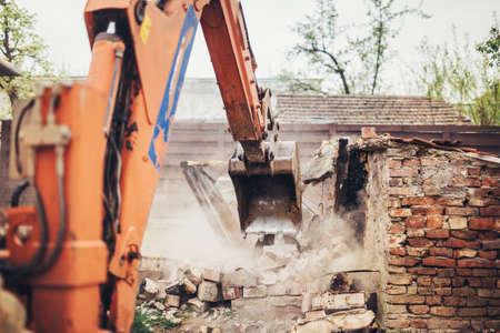 Heavy duty Hydraulic crusher excavator backoe machinery working on site demolition