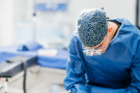 Young male surgeon getting ready for first operation. Cardiac specialist doctor getting ready for transplant Stock Photo
