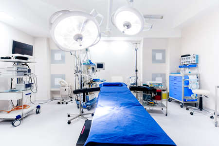 Close up details of hospital interior. Operating room with surgery lamps and medical equipment