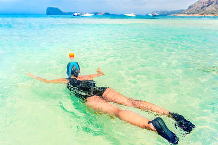 freediving: Young woman in honeymoon with snorkeling mask dive underwater with tropical fishes in coral reef sea pool.