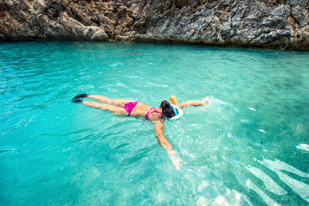 freediving: Concept of healthy living, sports and watersport details. Snorkeling with special equipment Stock Photo