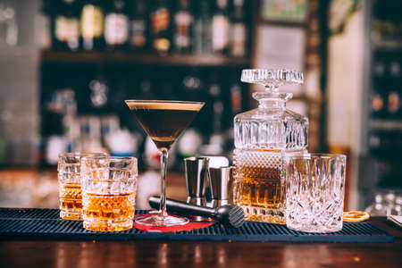delicious whiskey based cocktails, alcoholic beverages in modern bar Stock Photo