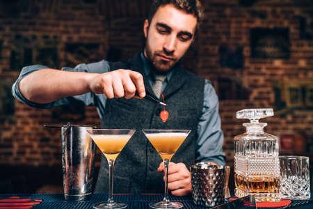 Portrait of barman preparing drinks in nightclub.