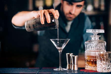 Dry martini close up. Preparation of martini at bar. Portrait of barman  Archivio Fotografico