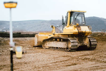 highway and road construction site with motor grader, excavator and bulldozer working