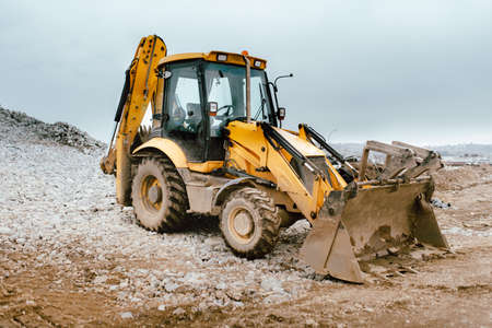 Industrial backhoe excavator and bulldozer in construction site Stock Photo