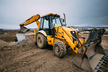 close up details of massive working machinery, industrial backhoe loader with excavator on construction site Stock fotó - 98354828