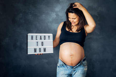 ready to become a mother concept - pregnancy shooting in studio Stock Photo