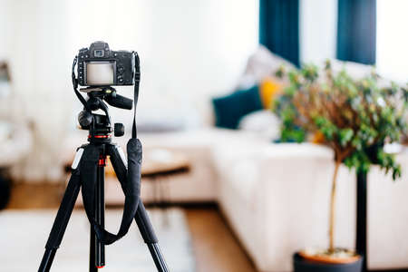 Camera on a tripod taking photographs of interior design, furniture and houses 写真素材