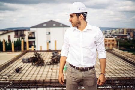 Portrait of confident architect, engineer on building construction site Foto de archivo