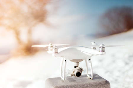 Drone quadcopter ready for flying. Flying drones in winter concept. Hobby uav ready for connection
