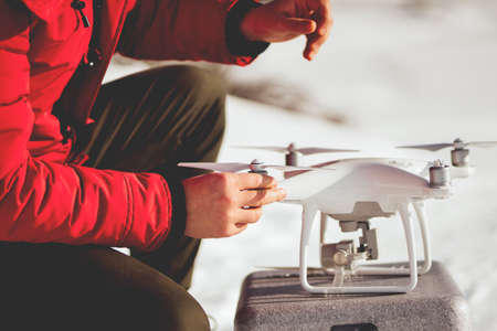 Installing drone propellers. Portrait of man getting ready for drone flying