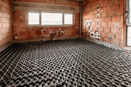 Details of underfloor heating and cooling during house construction. Plumbing details of flexible tubes and central heating system