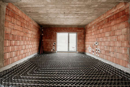 underfloor heating in construction of new residential house, construction details, plumbing Imagens