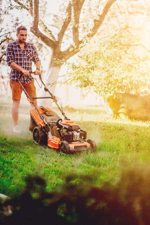 Gardening details and landscaping. Close up portrait of gardener worker Imagens