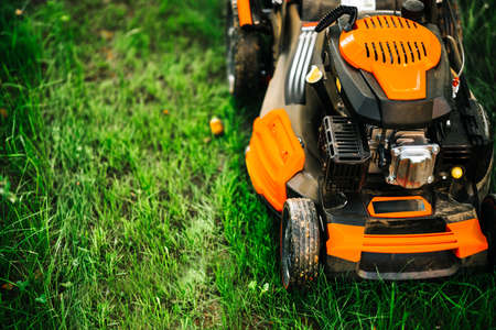 Garden and grass maintainance details - close up view of grass mower, lawnmower details 免版税图像