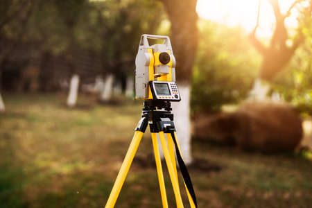 surveyor engineering equipment with theodolite and total station in a garden
