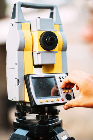landscaping details - survey engineer in garden elevation using total station theodolite