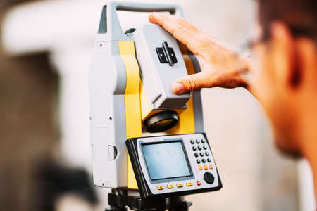 close up details of survey engineer working with total station theodolite at landscaping project Stock Photo