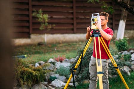 landscaping details - surveyor engineer working on ground elevation Stock Photo