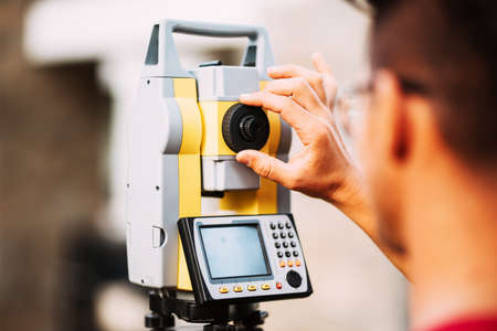 Close up details of surveyor engineer working with total station theodolite and gps system Stock Photo