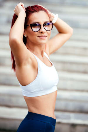 Close up portrait  of sporty, active woman in sportswear doing fitness training. Sport and fitness lifestyle concept Stock Photo