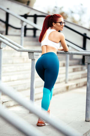 Portrait of attractive woman in sportswear doing fitness training. Sport and fitness concept