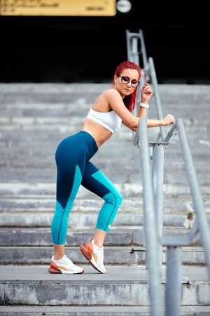 Close up portrait  of sporty, active woman in sportswear doing fitness training. Sport and fitness concept