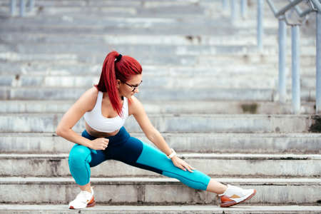 athletic caucasian woman doing stretching exercises and planks. Gym fitness sport concept