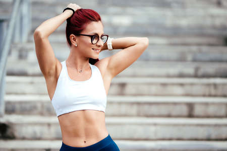 Close up portrait  of sporty, active woman in sportswear doing fitness training. Sport and healthy lifestyle concept