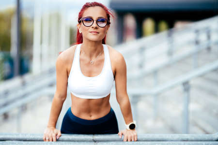 Professional athlete exercising and training. Portrait of woman working out