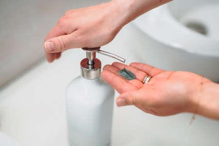 Responsible woman washing hands at home during quarantine