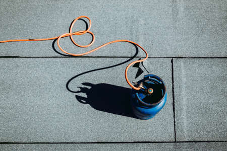 Details of waterproofing at house construction. Propane gas blowtoch details