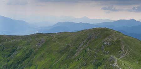 hiking path on mountain with panoramic karawanken view goldeck Stock Photo