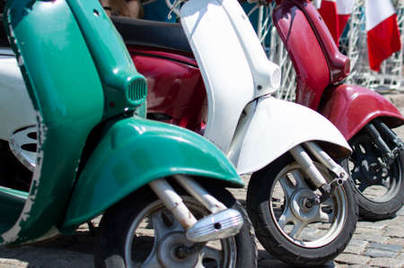 Red, green and white scooters symbolize the prapor of Italy, close-up of italian transport