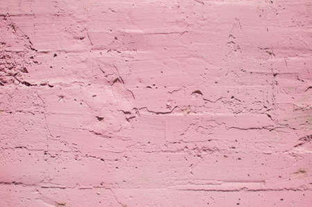 pink textured wall, dried paint strokes on the old wall Фото со стока