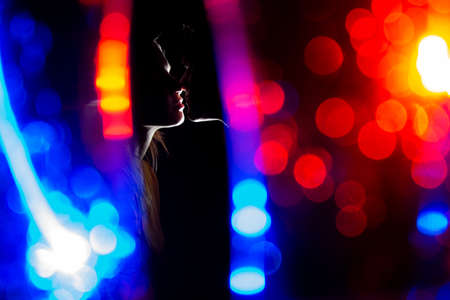 the girl and the guy kiss on Christmas in the backlight, young couple kiss on the night of the new year Stok Fotoğraf