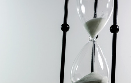 the passing of time: Hourglass - passing time concept