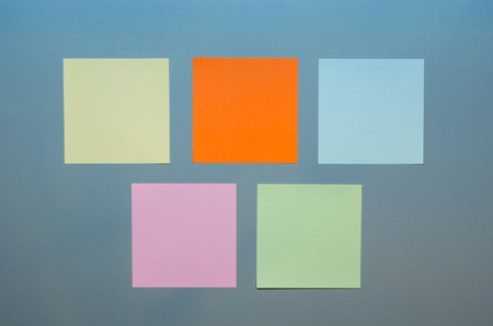reminders: Five colored empty reminders on a grey panel