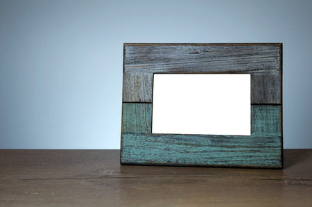 provided: Old wooden photography frame on the table. Space for text or photo provided Stock Photo