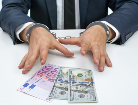 handcuffed: Greedy businessman handcuffed Stock Photo