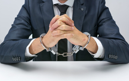young  cuffs: Businessman with handcuffs