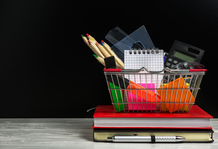 Back to school concept with many school supplies in a shopping cart