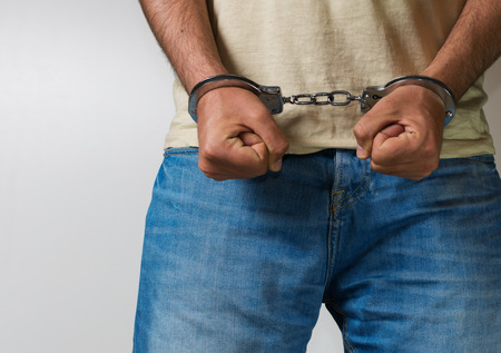 arrested: Young male arrested with handcuffs