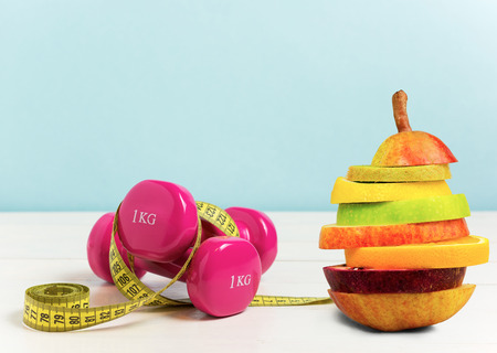 Concept for exercise and diet. Lose weight by eating healthy and practice sport
