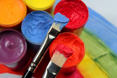 Paint brushes with opened paint buckets Stock Photo