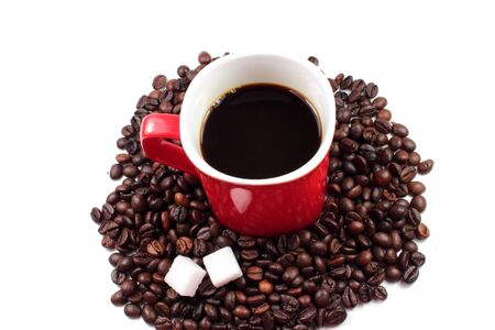 Red mug of coffee with roasted coffee beans and sugar lumps Stock Photo
