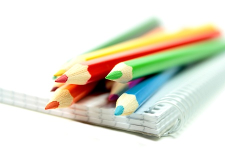 Colorful pencils with notebook on white background Stock Photo - 15023671